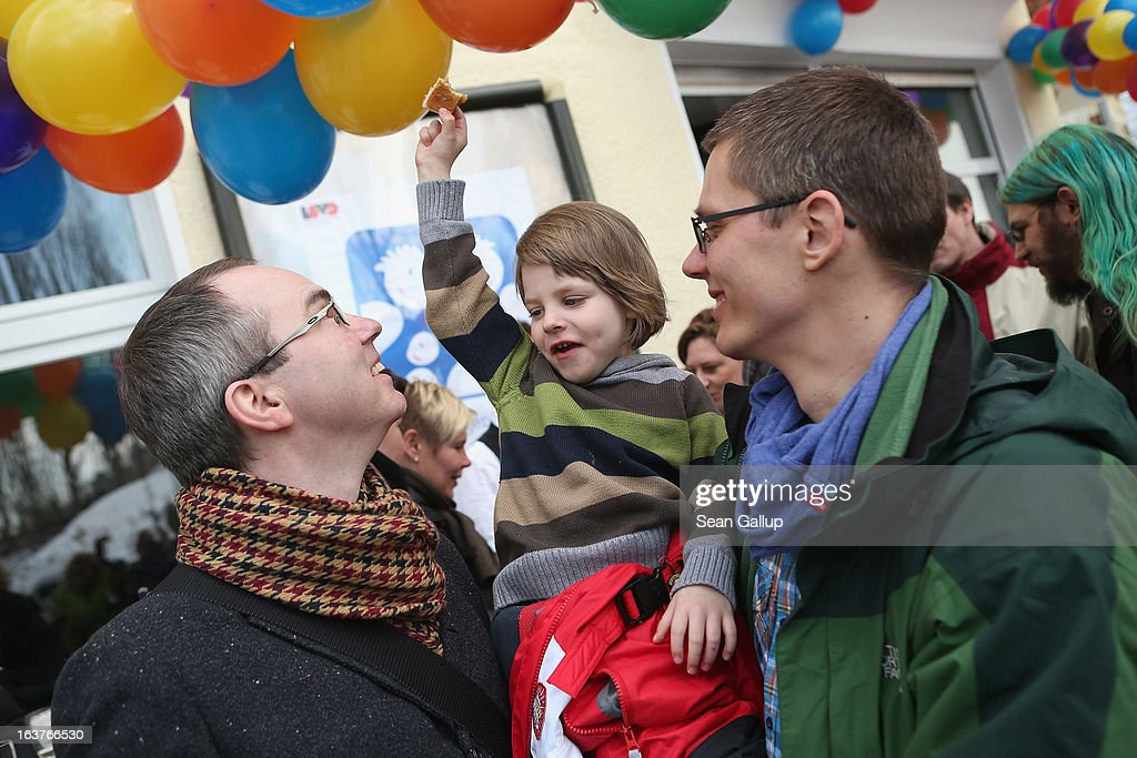 Gay couple Kai (L) and Michael Korok and their daughter Jana, 4, attend the opening of Germany's first gay parent counseling center on March 15, 2013 in Berlin, Germany. The Regenbogenfamilien Zentrum (Rainbow Families Center) will provide counseling and other services to families with gay, lesbian and transgender parents. Gay marriage is legal in Germany though gay couples are not entitled to the same full legal rights as heterosexual couples, and the issue of child adoption by gay couples remains legally somewhat complicated.