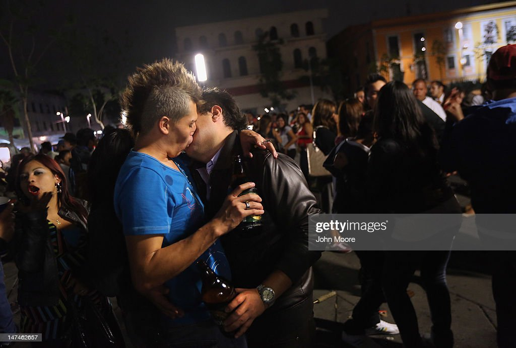 A gay couple kiss as they dance to mariachi music at Garibaldi Plaza early on June 30, 2012 in Mexico City, Mexico. Revelers partied into the early hours of the morning, even as a midnight ban on the sale of alcohol or 'ley seca' went into effect. Mexicans go to the polls Sunday to choose a new president.