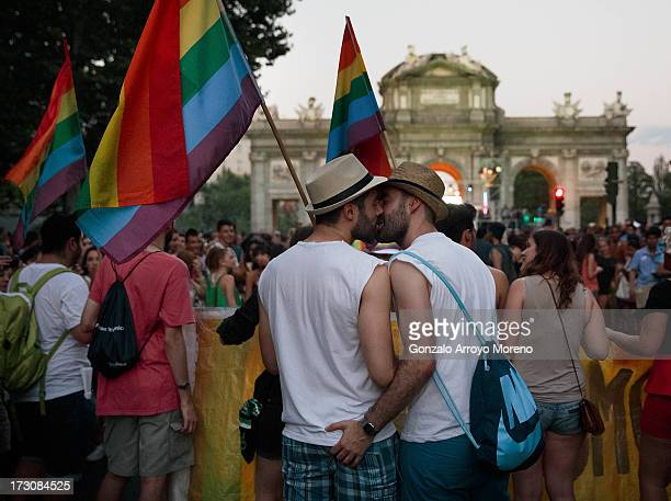 A gay couple kiss as they walk to Puerta de Alcala during the Madrid Gay Pride Parade 2013 on July 6 2013 in Madrid Spain According to a new Pew...