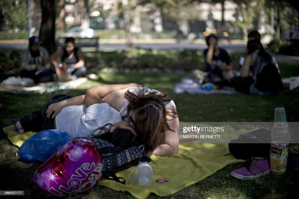 A gay couple kiss during the Valentine's Day celebration in a Balmaceda Park in Santiago, Chile on February 14, 2014.