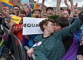A gay couple kiss in Dublin Castle Square as the result of the referendum is relayed on May 23 2015 in Dublin Ireland Voters in the Republic of...