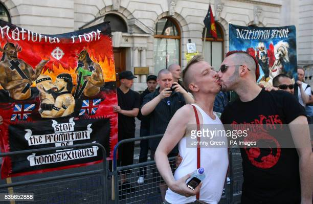 A gay couple kiss in front of a small National Front demonstration only 12people strong as more than half a million lesbian gay bisexual and...