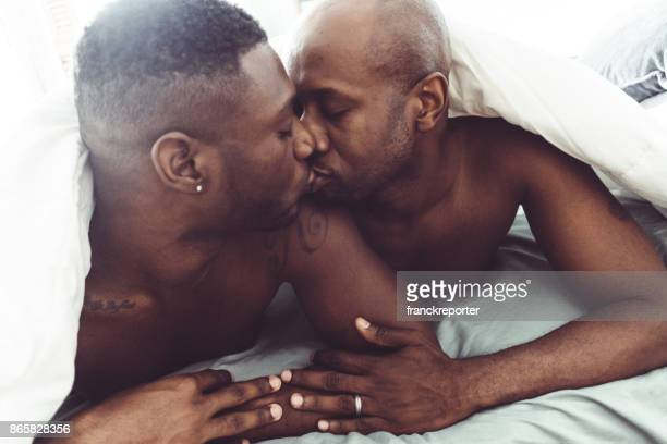 gay couple kissing and make sex in the bed
