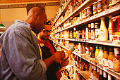 Gay couple looking at condiment bottle