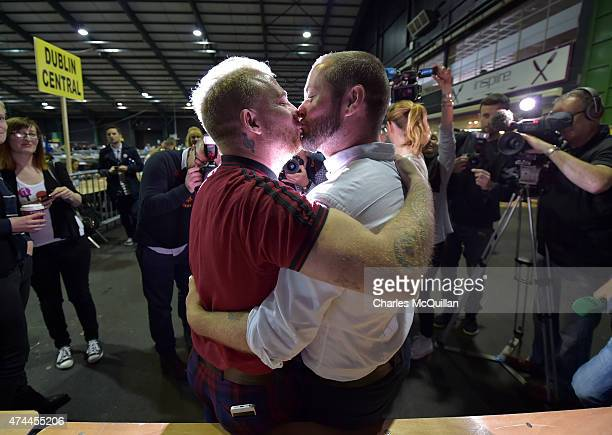 Gay couple Michael Barron and Jamie Nanci who were married in Cape Town South Africa kiss at the RDS count centre on May 23 2015 in Dublin Ireland...