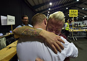 Gay couple Michael Barron and Jamie Nanci who were married in Cape Town South Africa embrace at the RDS count centre on May 23 2015 in Dublin Ireland...