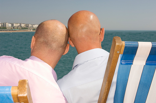 Gay Couple Relaxing on Beach