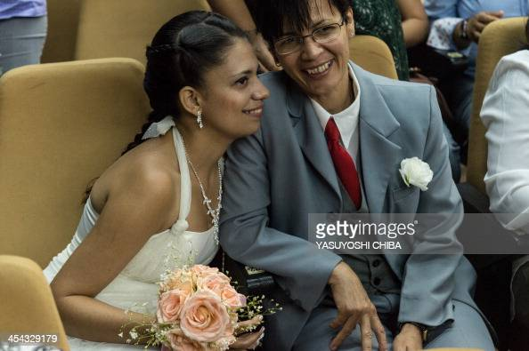 A gay couple smiles during their wedding ceremony at the Court of Justice of the State of Rio de Janeiro on December 8 2013 130 gay couples are...