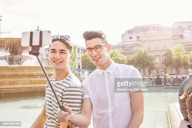 Gay couple taking Selfie in Trafalgar square