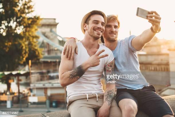 Gay couple taking selfie on their road trip around Europe