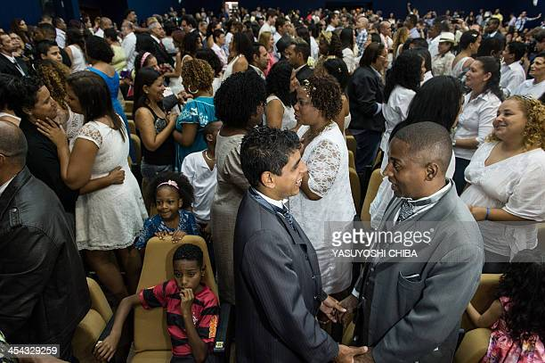 Gay couples take marriage vows during their wedding ceremony at the Court of Justice of the State of Rio de Janeiro on December 8 2013 130 gay...