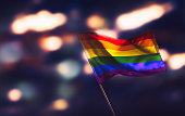 Gay flag waving with pride