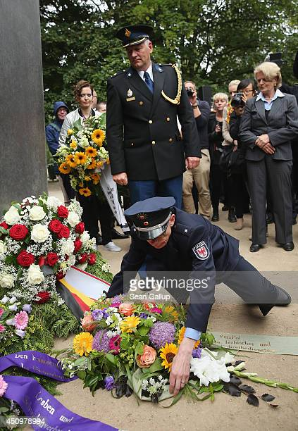 Gay German police members in uniform lay a wreath at the memorial to homosexuals murdered in the Holocaust by the Nazis prior to the annual...