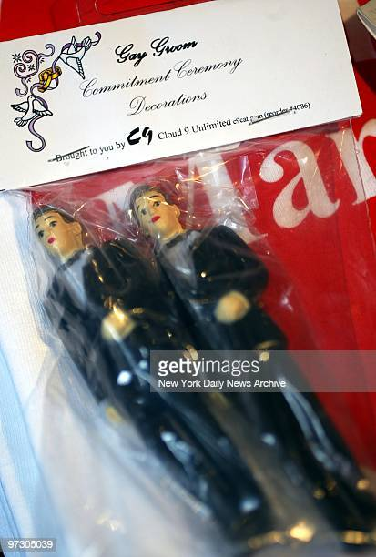 Gay Groom's samesex wedding cake toppers seen at the shop Don't Panic on Commercial St are among numerous gay weddingrelated items for sale in...