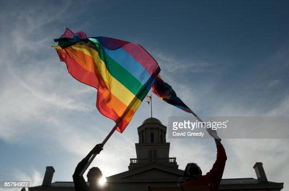 Gay lesbian and transgender activists react to the unanimous decision by the Iowa Supreme Court earlier in the day recognizing same sex marriage as a...