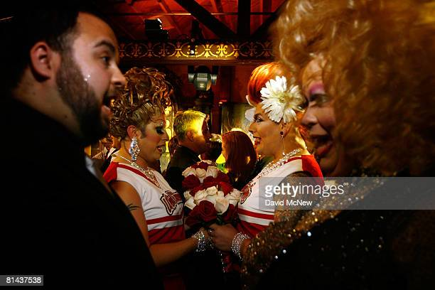 Gay male couples Psychadella Fuchade and Topher Sterling and Sparkle Stone and Holly Ween are dressed in costume as they participate in a symbolic...