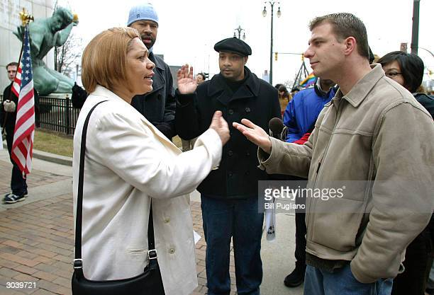 Gay marriage advocates and opponents argue their views in front of the Wayne County citycounty building March 3 2004 in Detroit Michigan Seven gay...