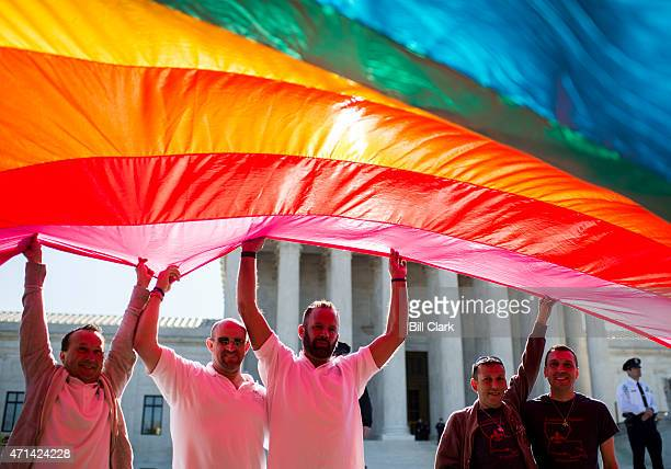 Gay marriage rights activists hold a giant rainbow flag outside the US Supreme Court before the start of oral arguments on marriage equality on...