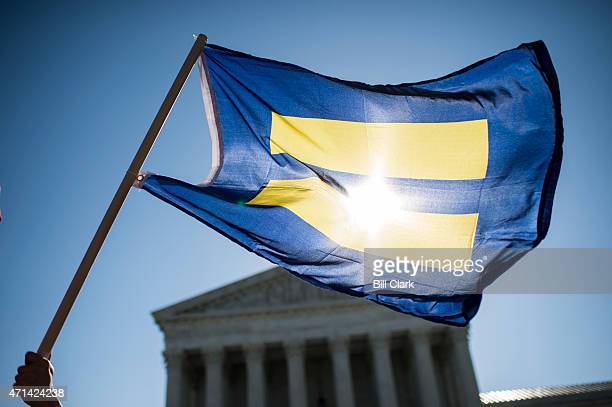 Gay marriage rights wave equality flags outside the US Supreme Court before the start of oral arguments on marriage equality on Tuesday April 28 2015