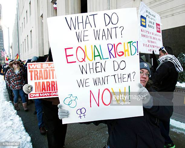 Gay marriage supporters protest next to protraditional marriage supporters in front of the US Federal Courthouse March 3 2014 in Detroit Michigan...