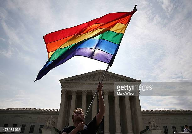 A gay marriage waves a flag in front of the Supreme Court Building June 25 2015 in Washington DC The high court is expected rule in the next few days...
