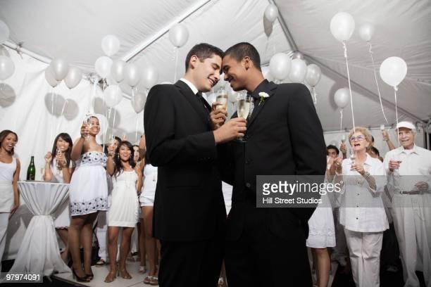 Gay married couple enjoying wedding reception