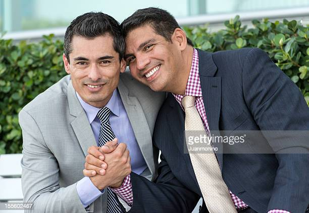 Gay mature executives holding hands