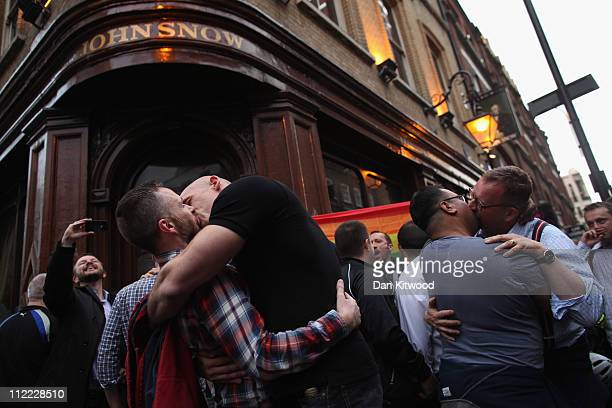Gay men and women gather outside the John Snow pub in Soho to stage a group kiss on April 15 2011 in London England The demonstartion took place...