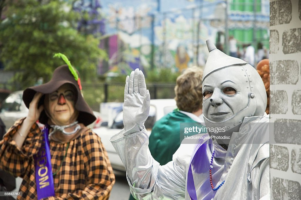 Gay men dressed as a scarecrow and a tin man at the Gay Pride Parade, New York City, NY, USA : Stock Photo