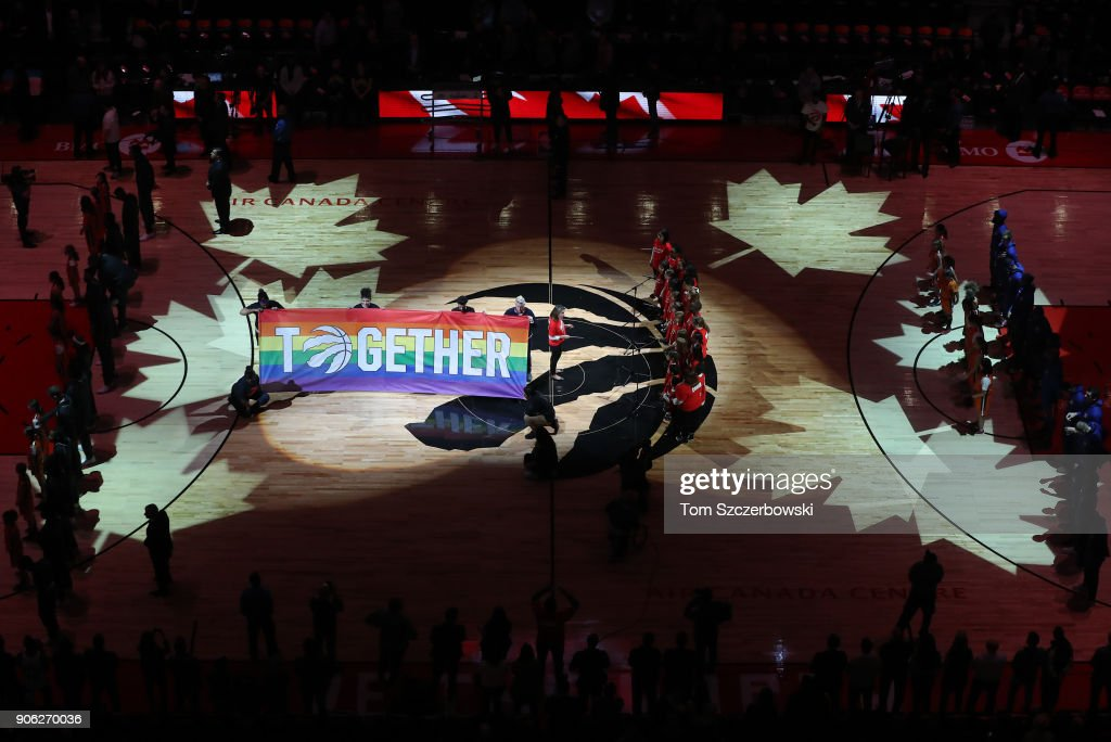 A gay pride flag is displayed on You Can Play Night during the singing of the Canadian anthem before the Toronto Raptors NBA game against the Detroit Pistons at Air Canada Centre on January 17, 2018 in Toronto, Canada.