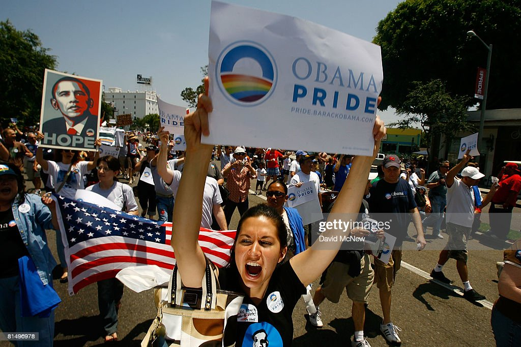 Gay pride participants hold signs in support of Democratic presidential hopeful Barack Obama at the 38th annual LA Pride Parade June 8 2008 in West...