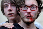 A gay rights activist is seen after clashes with antigay demonstrators during a gay pride event in St Petersburg on June 29 2013 Russian police...