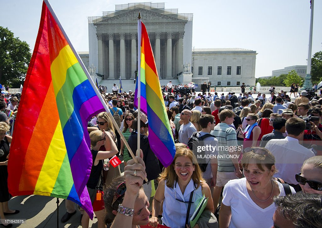 Gay rights activists gather outside the US Supreme Court building in Washington DC on June 26 2013 The US Supreme Court on Wednesday struck down a...