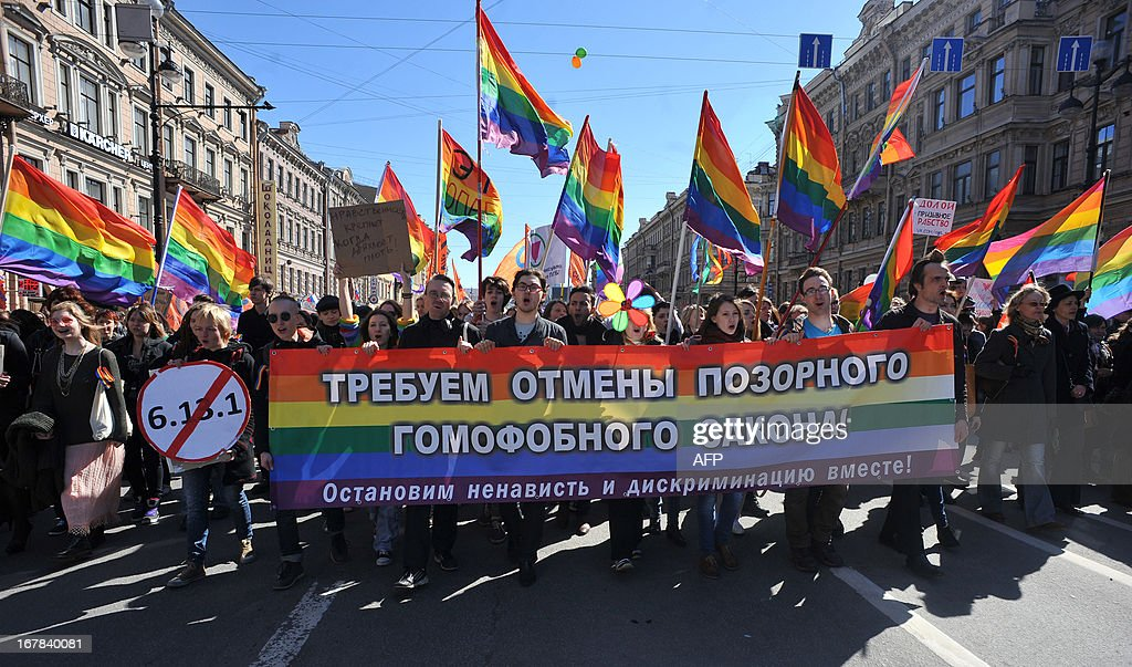 Gay rights activists march in Russia's second city of St. Petersburg May 1, 2013, during their rally against a controversial law in the city that activists see as violating the rights of gays. The banner reads: 'We demand to abrogate the shameful homophobic law!'