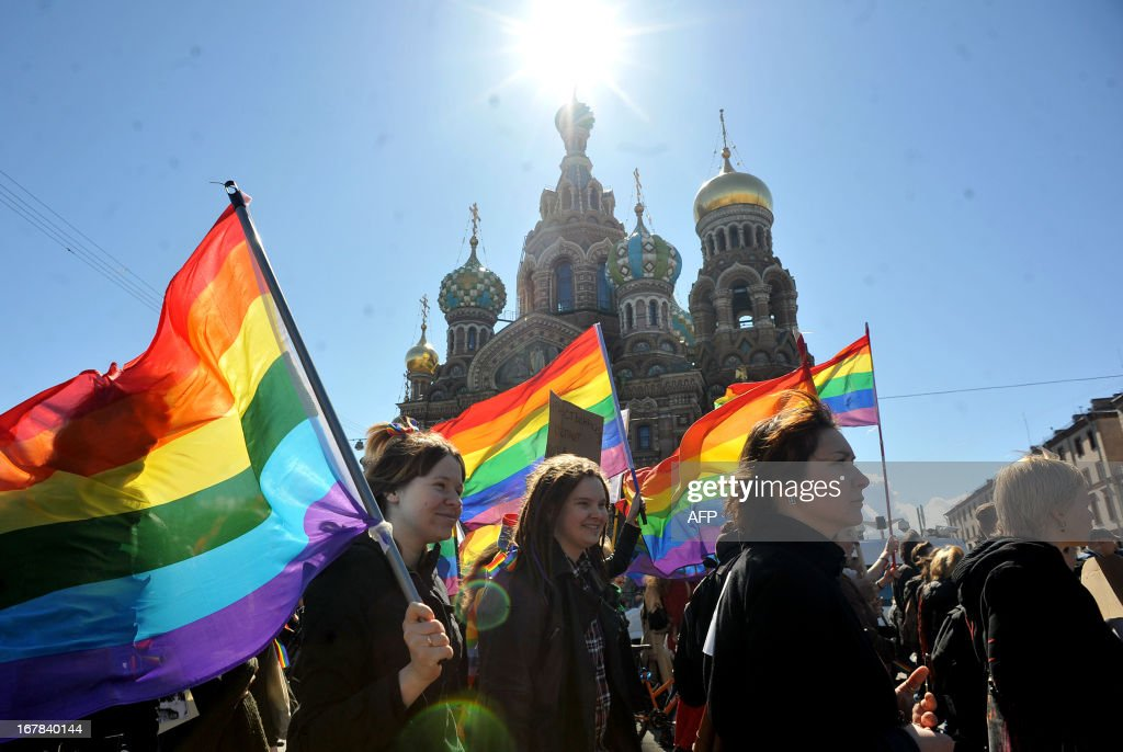 Gay rights activists march in Russia's second city of St Petersburg May 1 during their rally against a controversial law in the city that activists...