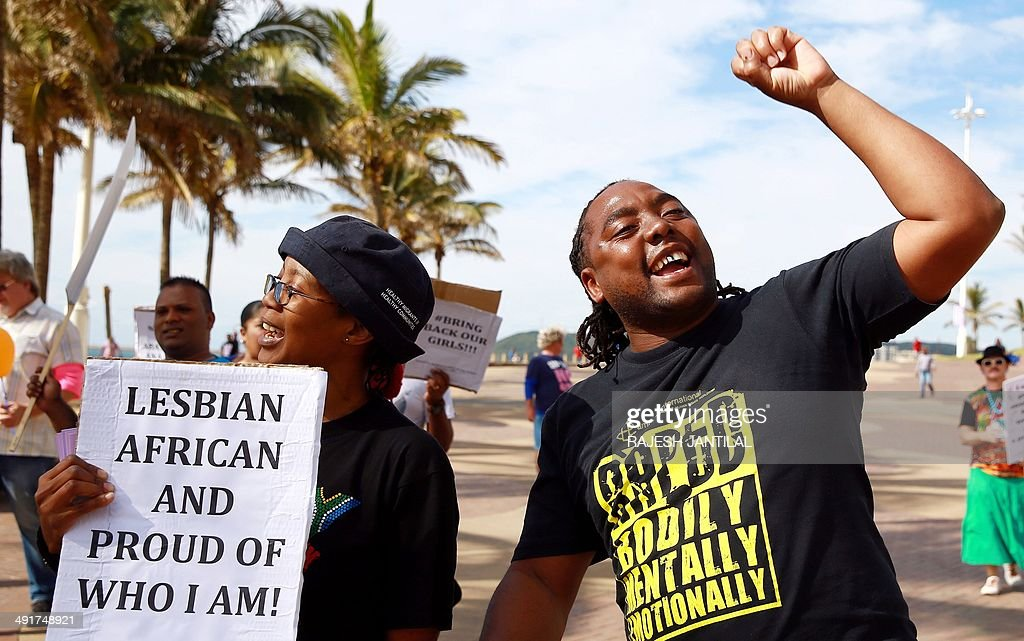 Gay rights activists participate in a demonstration rally marking the International Day Against Homophobia and Transphobia (IDAHOT) at the North Beach in Durban, on May 17, 2014. The 9th annual event, billed by organisers as the biggest LGBT solidarity event in the world, is aimed at raising awareness about discrimation facing the community and at calling for equal rights.