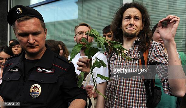 Gay rights activists protest against a bill banning homosexual 'propaganda' among minors outside the lower house of Russias parliament the State Duma...