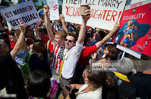Gay rights activists react outside the US Supreme Court building in Washington DC on June 26 2013 The US Supreme Court on Wednesday struck down a...