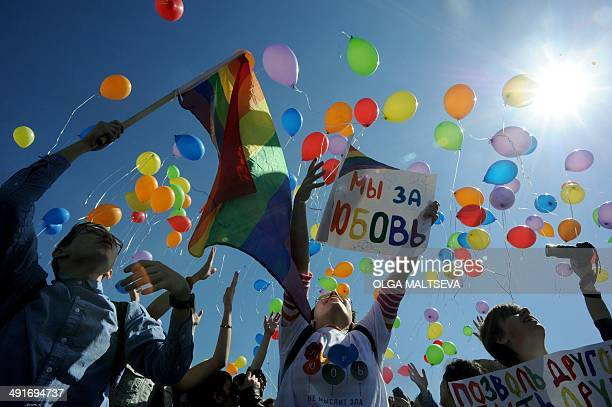 Gay rights activists release balloons as they take part in a flash mob devoted to the World Day Against Homophobia and Transphobia in St Petersburg...