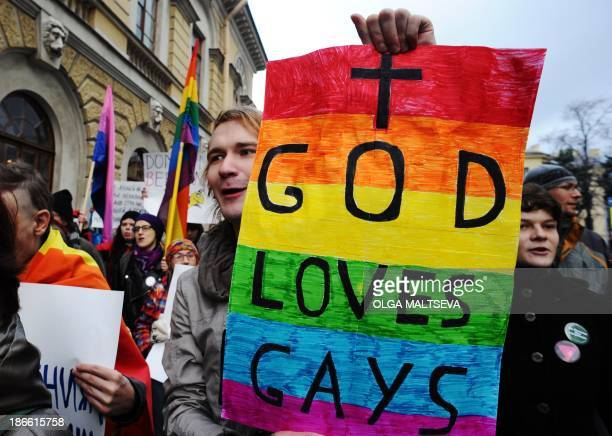 Gay rights activists take part in a joint opposition rally called 'March against Hatred' in the Russia's second city of St Petersburg on November 2...