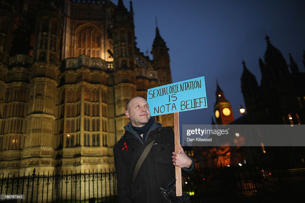 Gay rights campaigner Paul Bennett, 44, of London stands outside The Houses of Parliament on February 5, 2013 in London, England. Later Parliament will hold a vote on whether to allow homosexual couples to marry.