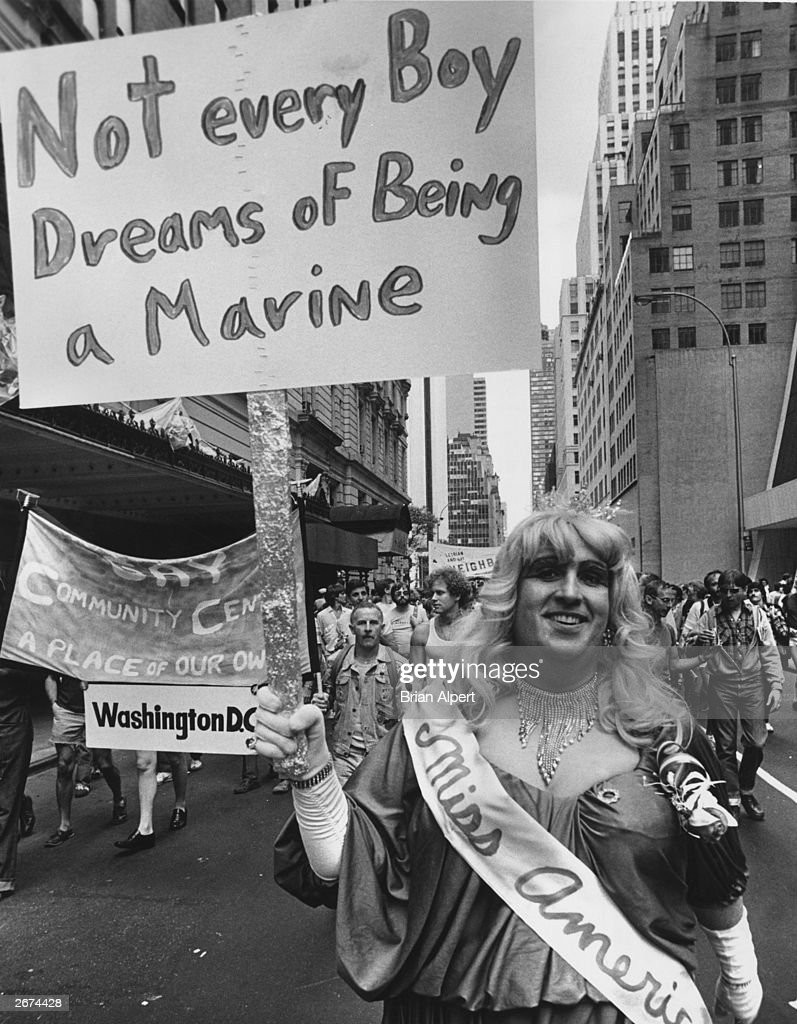 A gay rights protester in drag with a banner declaring 'Not Every Boy Dreans Of Being A Marine' during a Gay Rights march up Fifth Avenue to Central...