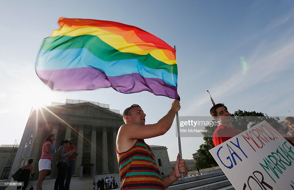 Gay rights supporter Vin Testa waves a rainbow flag outside the US Supreme Court building on June 26 2013 in Washington DC The high court is expected...