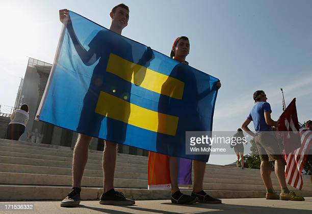 Gay rights supporters Brian Sprague and Charlie Ferrusi from Albany New York hold a Human Rights flag outside US Supreme Court building on June 26...