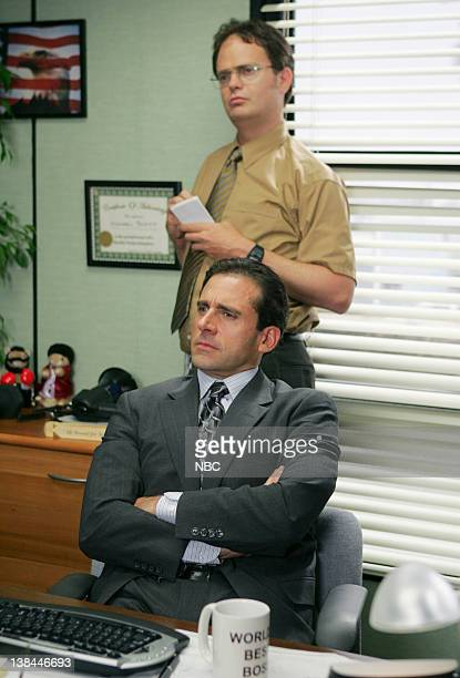 THE OFFICE 'Gay Witch Hunt' Episode 1 Aired Pictured Steve Carell as Michael Scott front and Rainn Wilson as Dwight Schrute back