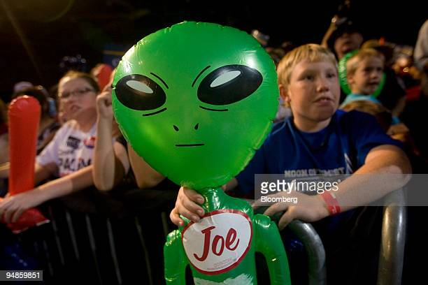 Gaylan Young holds a toy alien during a campaign rally speech by Senator John McCain of Arizona Republican presidential candidate in Roswell New...