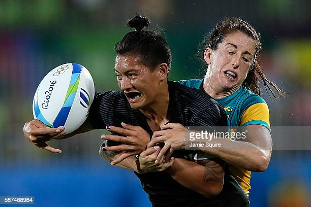 Gayle Broughton of New Zealand is tackled by Alicia Quirk of Australia during the Women's Gold Medal Rugby Sevens match between Australia and New...
