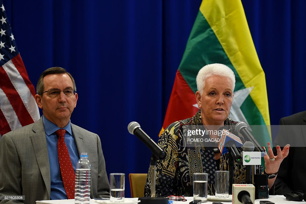 Gayle Smith (R), administrator of the United States Agency for International Development (USAID), accompanied by US Ambassador to Myanmar Scot Marciel (L), speaks at a press conference at the US embassy in Yangon on May 3, 2016 at the conclusion of her three-day visit as part of mission to provide assitance to Myanmar. Smith met leaders from civil society, government and the private sector in her first trip to Asia, visiting China and Myanmar. / AFP / ROMEO