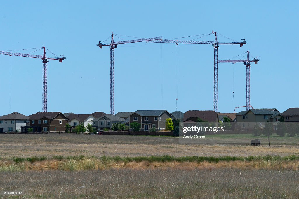 Gaylord Rockies Resort and Convention Center construction cranes tower over and behind a housing development June 24, 2016.
