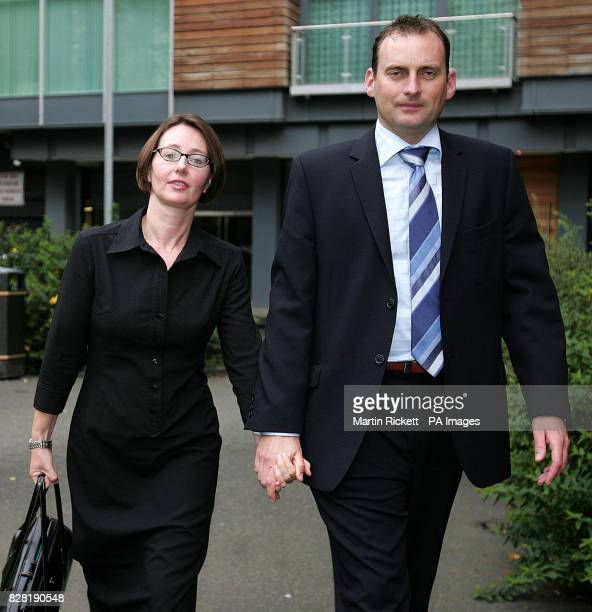Gaynor Stobie and her husband Craig leaves an employment tribunal in Manchester Tuesday October 4 2005 where she is claiming discrimination against...
